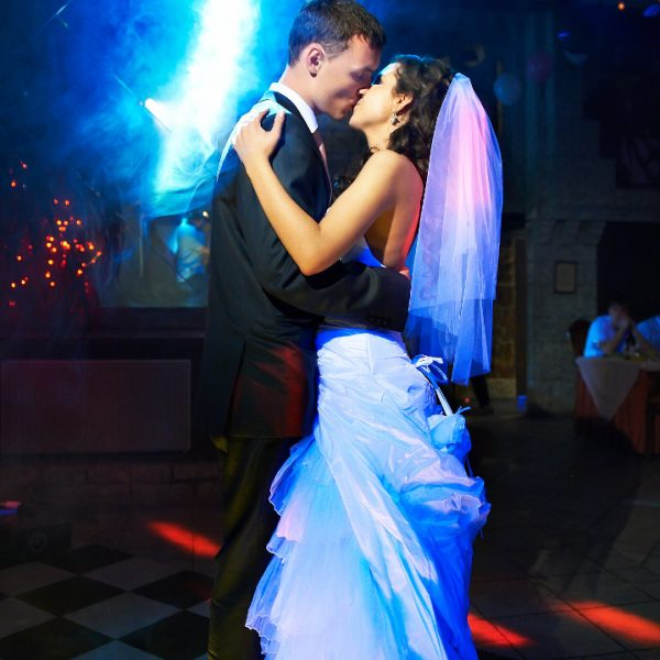 Kiss,And,Dance,Young,Bride,And,Groom,In,Dark,Banqueting